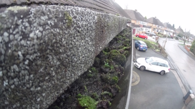 Gutter Cleaning in Castle Bromwich Prevents Sweeping up the Moss